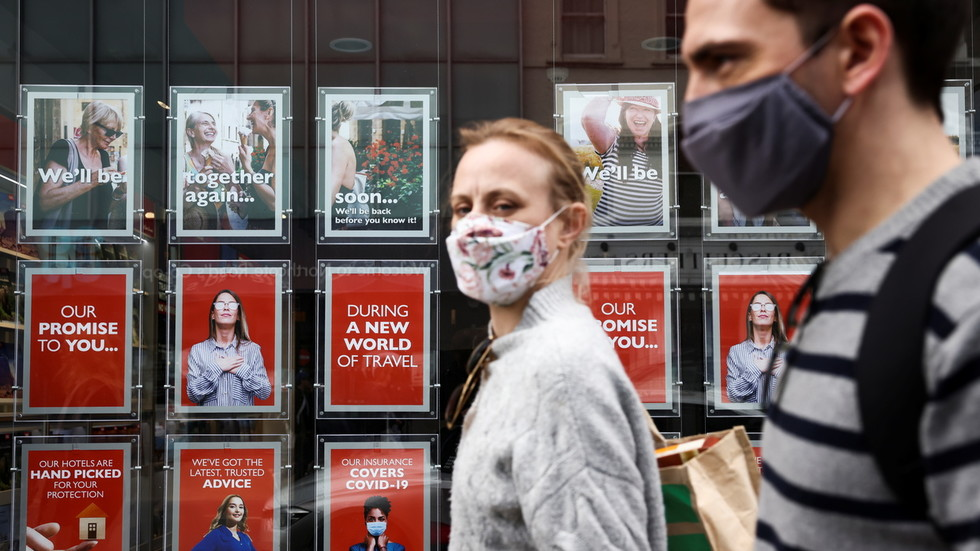 Masks and distancing could be required for several more YEARS, British public health expert says